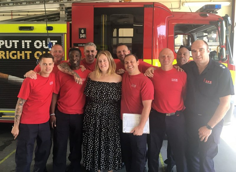 In photos: Singer Adele visits London Grenfell Tower firefighters