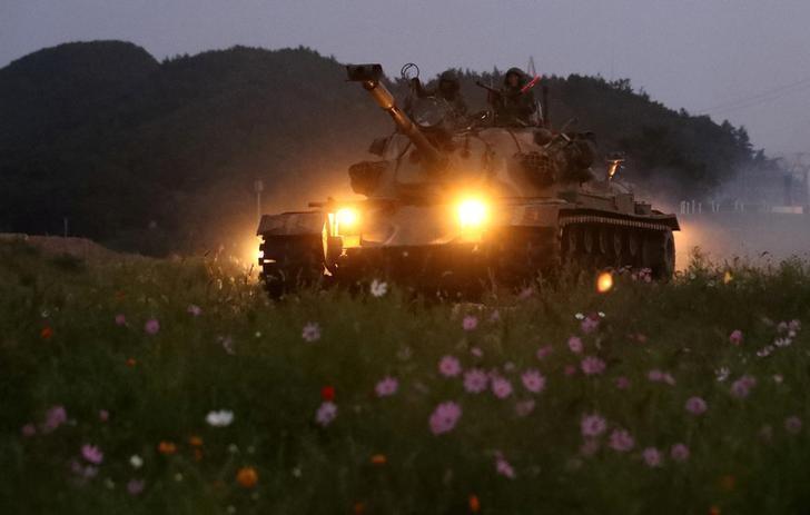U.S. adds launchers, dozens hurt in S Korea protests