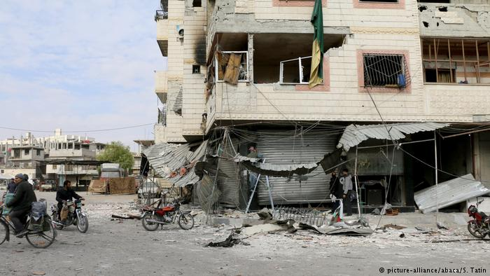 Syria activists: Government attacks outside Damascus kill 19