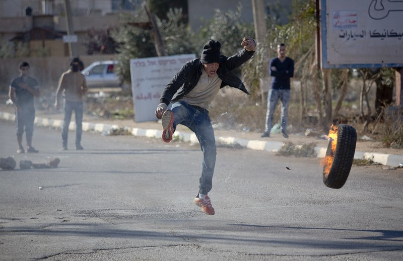 Police probe Israeli settlers after Palestinian shot dead in West Bank clash
