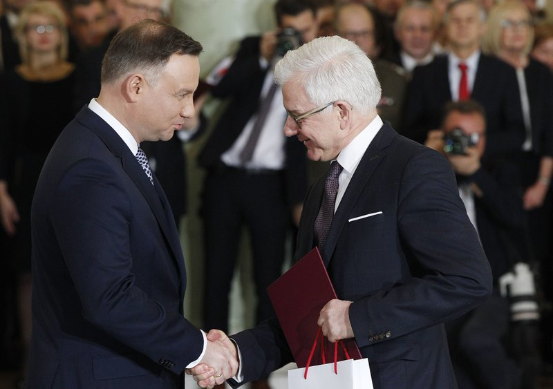 Polish president sacks defense, foreign ministers