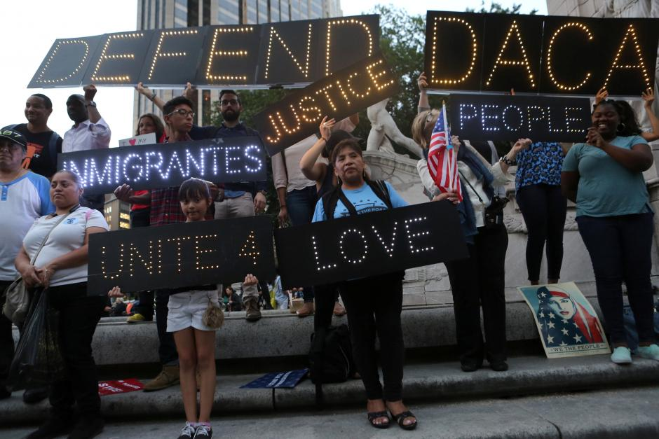 Federal judge temporarily blocks Trump administration's plan to end DACA