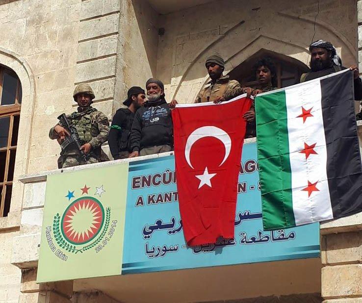 Syria monitors: Turkish-allied militiamen looting in Afrin