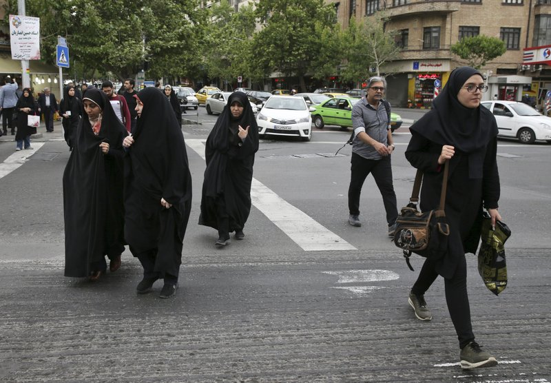 Iran police's assault on woman over headscarf stirs debate