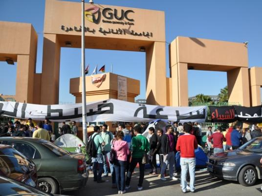 Protest in front of the entrance to the german university for Cairo outlet