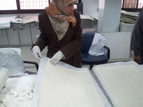 Book restoration at Dar al-Kotob: Conservators drying books